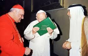 Pope John Paul kissing the Koran